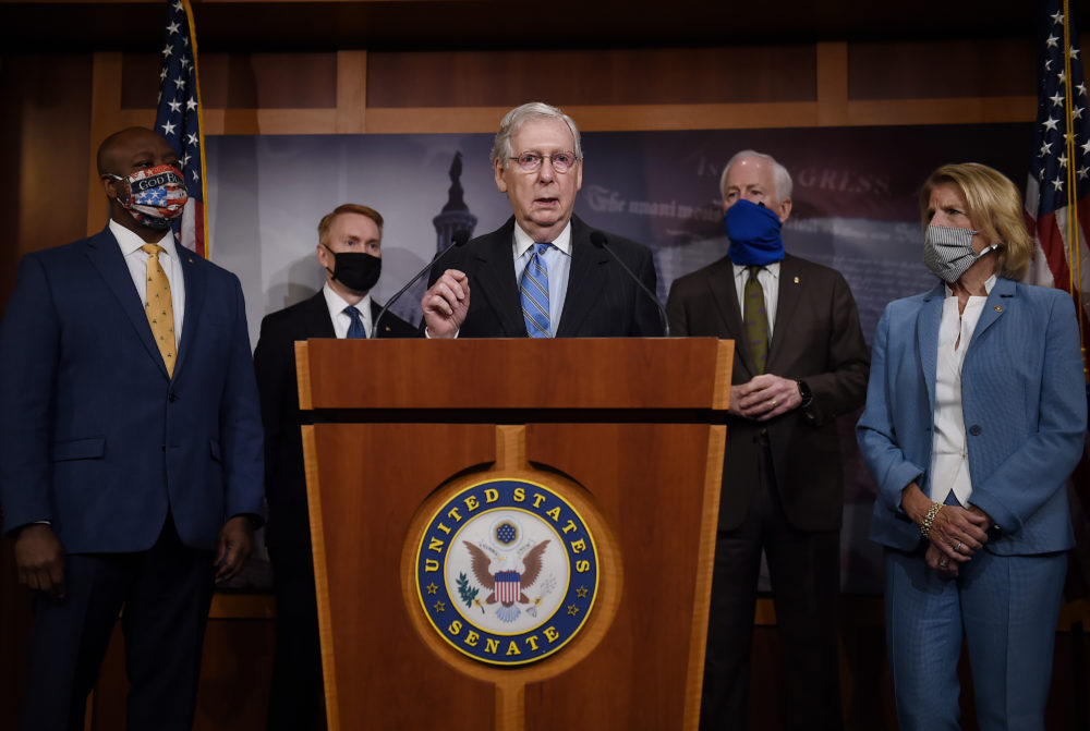 Senate Majority Leader Mitch McConnell flanked by (L to R) Sen. Tim Scott, R-SC,  Sen. James Lankford, R-OK, Sen. John Cornyn, R-TX, and Sen. Shelley Moore Capito, R-WV, speaks at a news conference to announce a Republican police reform bill  a news conference to announce that the Senate will consider police reform legislation, at the US Capitol on June 17, 2020 in Washington, DC. (Olivier Douliery/AFP via Getty Images)