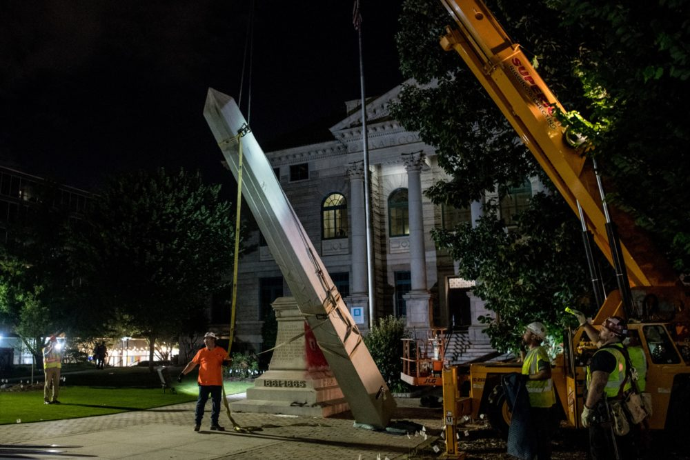 Crew members work to remove a 30-foot Confederate monument on June 19, 2020, in Decatur, northeast of Atlanta, Georgia. (Chandan Khanna/AFP via Getty Images)