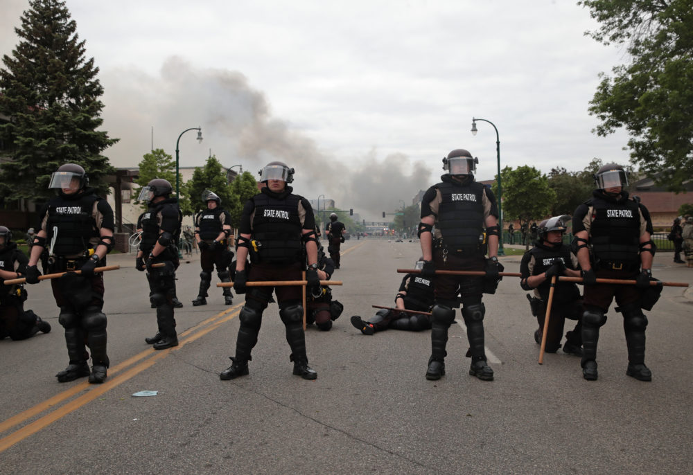 Police officers block a road on the fourth day of protests on May 29, 2020 in Minneapolis, Minnesota. (Scott Olson/Getty Images)