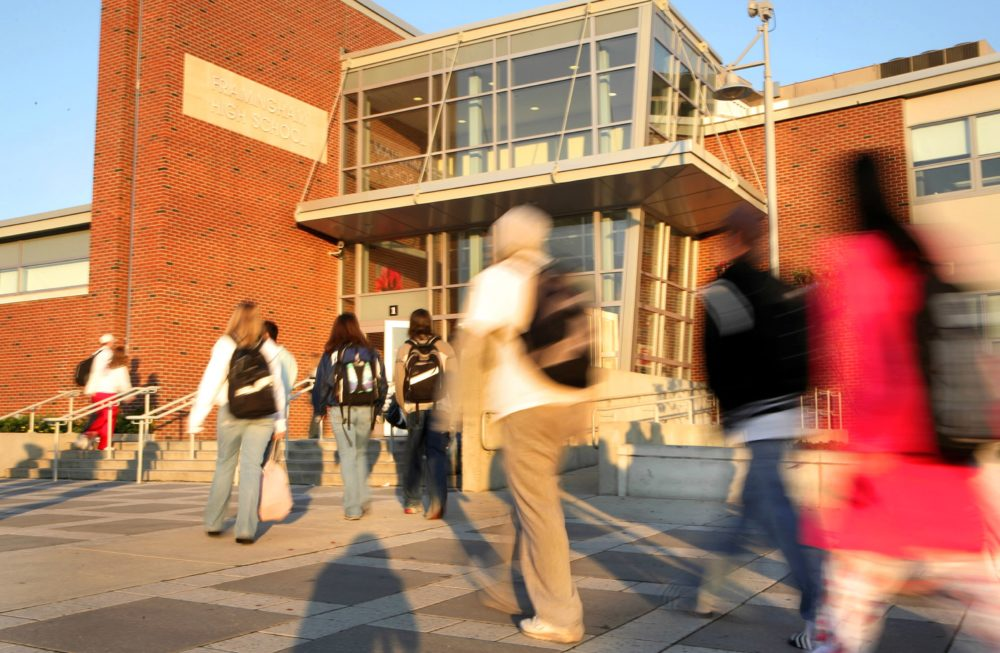 In this file photo, students walk outside Framingham High School at the start of their school day. (Melanie Stetson Freeman/The Christian Science Monitor via Getty Images)