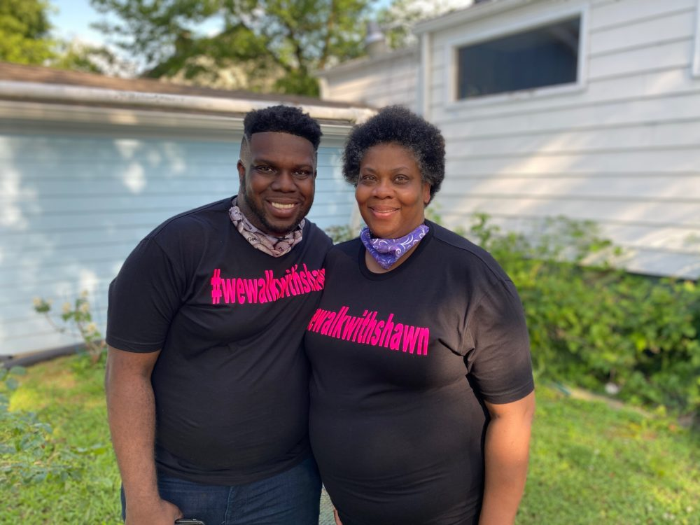 Shawn Dromgoole, 29, next to his mother Lynetra Dunn during an organized neighborhood walk. (Courtesy Shawn Dromgoole)