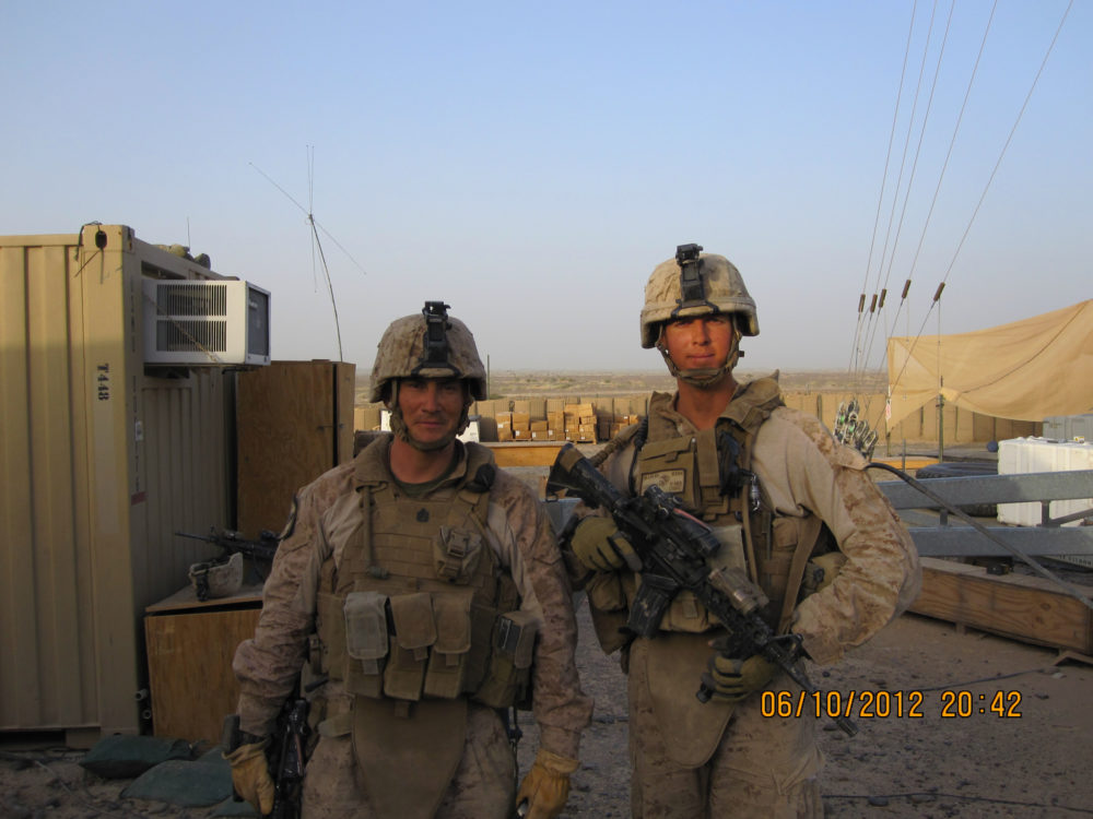 The author, R, with a fellow Marine, L, in Helmand Province, Afghanistan, where he commanded infantry in 2012. (Courtesy Jake Auchincloss)