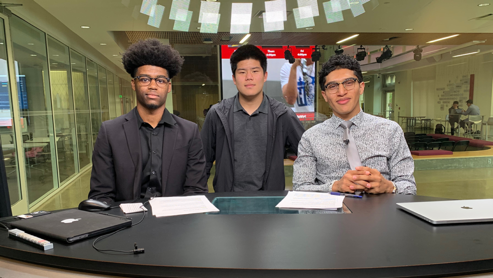"""Reagan Griffin Jr. (left) with his podcast co-hosts Eddie Sun (middle) and Julio Martinez (right). Together they host a podcast called, """"Hoop and Holler."""" (Courtesy Reagan Griffin Jr.)"""
