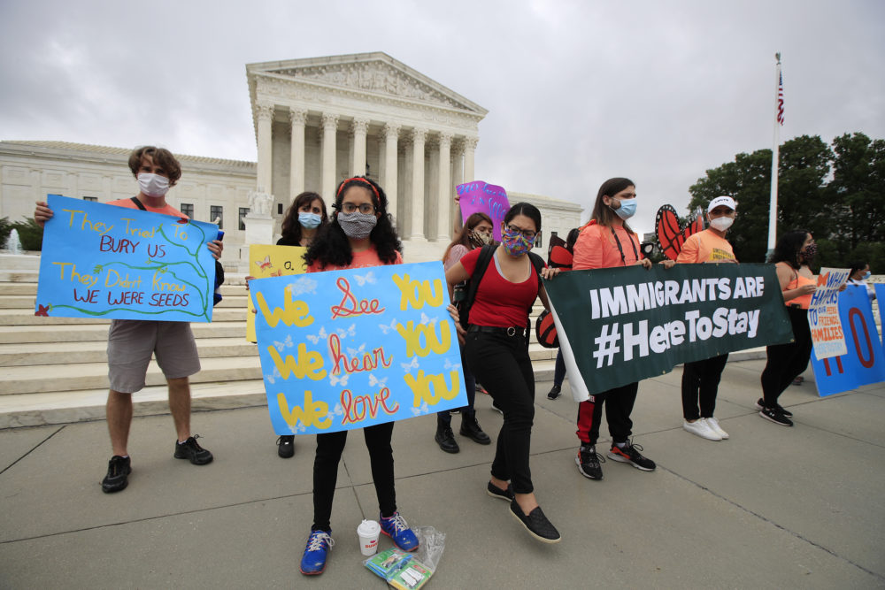 Deferred Action for Childhood Arrivals (DACA) students celebrate in front of the Supreme Court after it rejected President Trump's effort to end legal protections for young immigrants on Thursday in Washington. (Manuel Balce Ceneta/AP)