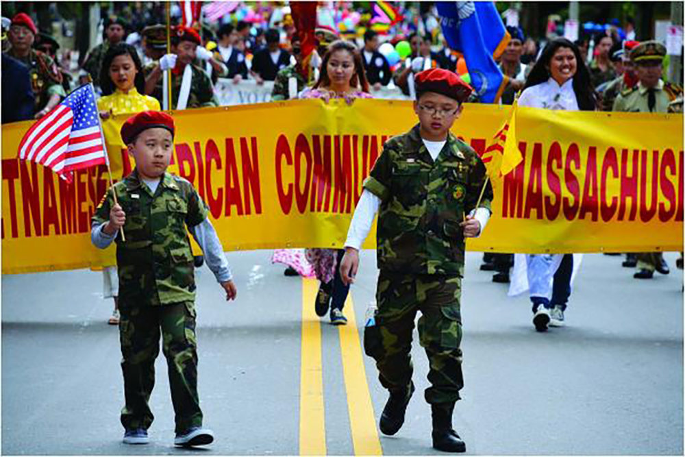 Two boys in uniform led a contingent of marchers representing the Vietnamese-American Community of Massachusetts in the Dorchester Day Parade last year. (Chris Lovett/Dorchester Reporter)