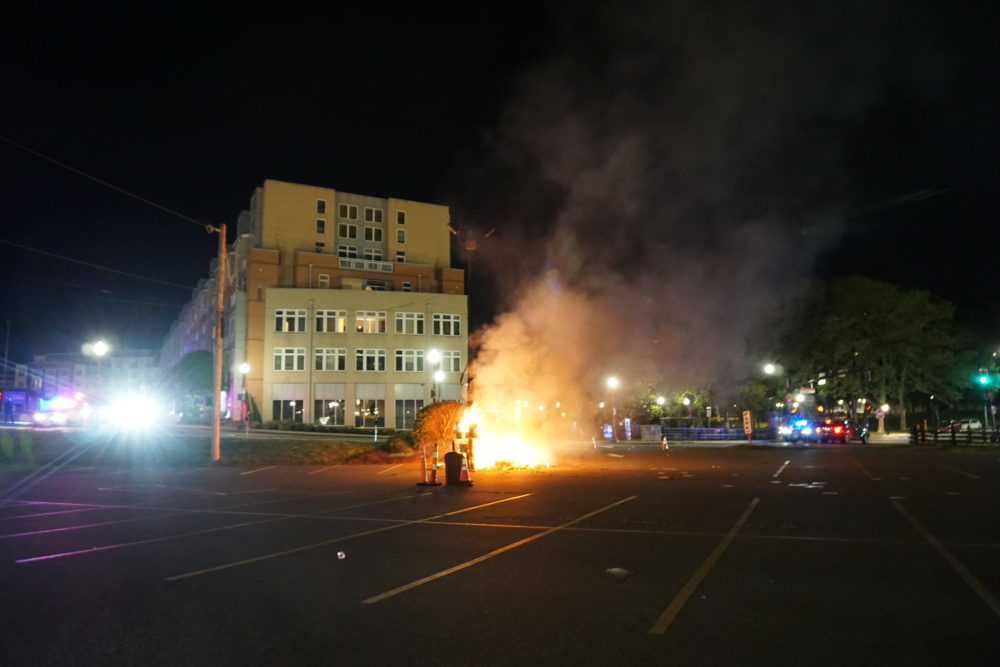 At Providence Place Mall on Monday night, some protesters smashed windows and set small fires in trash cans and on sidewalks.(The Public's Radio/RIPR)