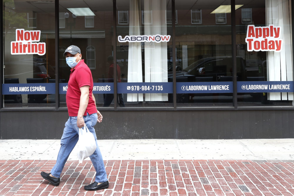 A man walks by a career center storefront on June 5 in Lawrence, Mass. (Elise Amendola/AP)