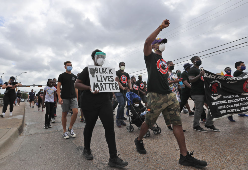Protesters march in a Black Lives Matter demonstration organized by the Dallas Black Firefighters Association on Juneteenth 2020 in Dallas on June 19, 2020. (LM Otero/AP)