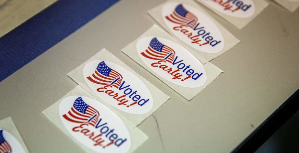 """I voted early"" stickers at early voting in Cambridge, Mass. in February 2020. (Robin Lubbock/WBUR)"