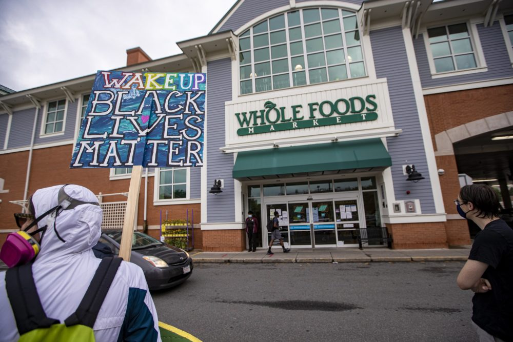 On a recent weekday, supporters of employees wanting to wear Black Lives Matter masks during their shifts gathered outside the store. (Jesse Costa/WBUR)