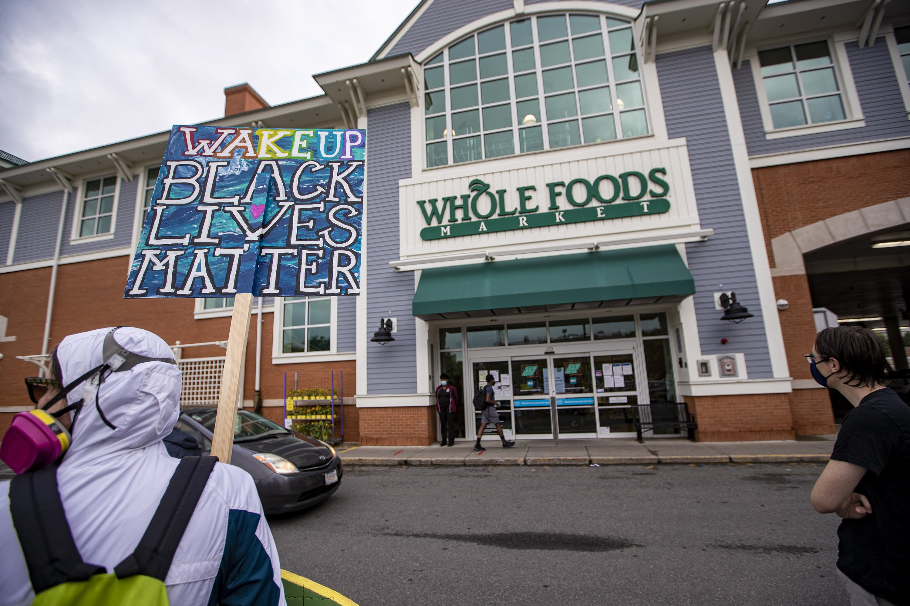 Supporters of employees wanting to wear Black Lives Matter masks during their shifts gathered outside the River St. Whole Foods in Cambridge in June 2020. (Jesse Costa/WBUR)
