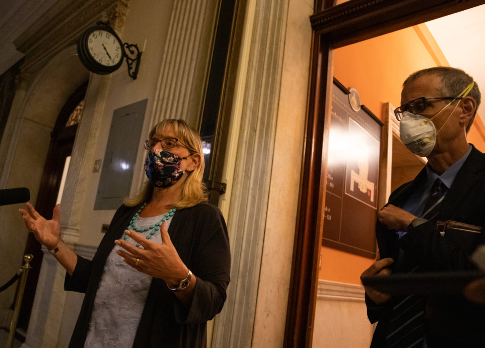 A clock on the corridor wall displayed the time -- 4:20 a.m. -- while Senate President Karen Spilka spoke to reporters outside the Senate Chamber early Tuesday morning, alongside Sen. William Brownsberger, after the branch passed a wide-ranging police reform bill during a marathon 16-hour session. (Sam Doran/SHNS)