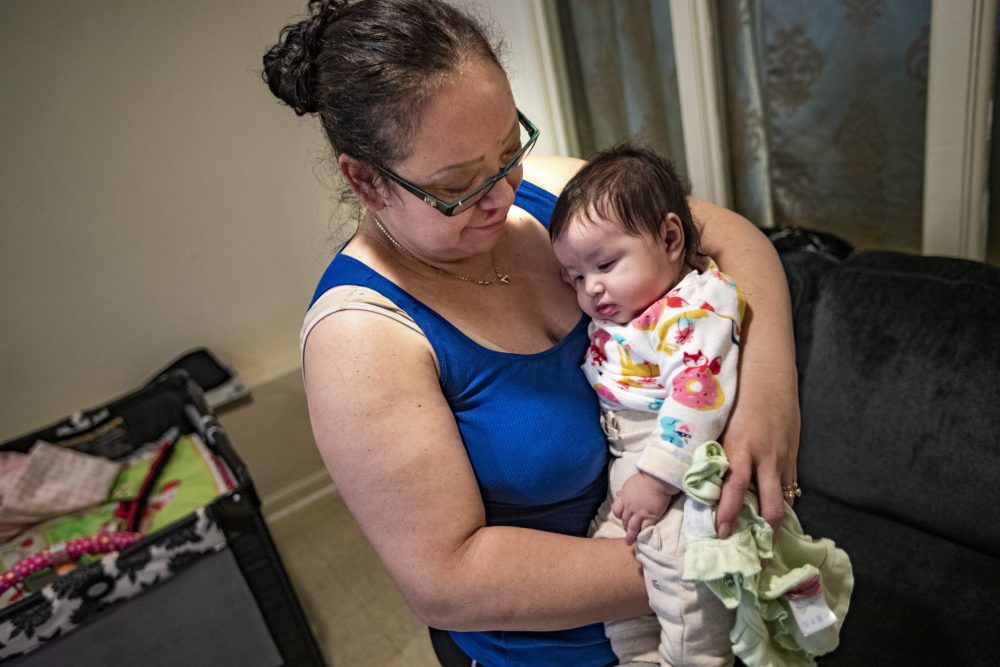 Carolina, with her 4-month-old daughter at her apartment in East Boston. (Jesse Costa/WBUR)