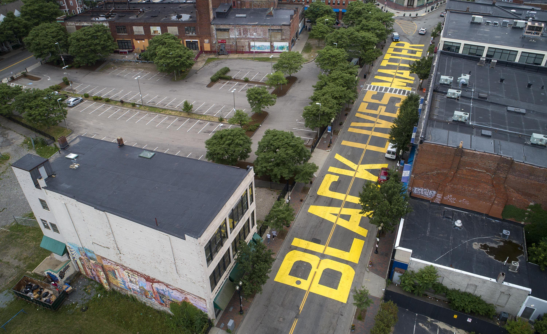 """Black Lives Matter"" painted across Washington Street between Eustis Street and Palmer Street. (Robin Lubbock/WBUR)"