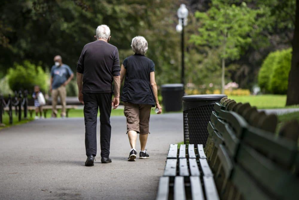 An older couple out for a walk through the Boston Public Garden. (Jesse Costa/WBUR)