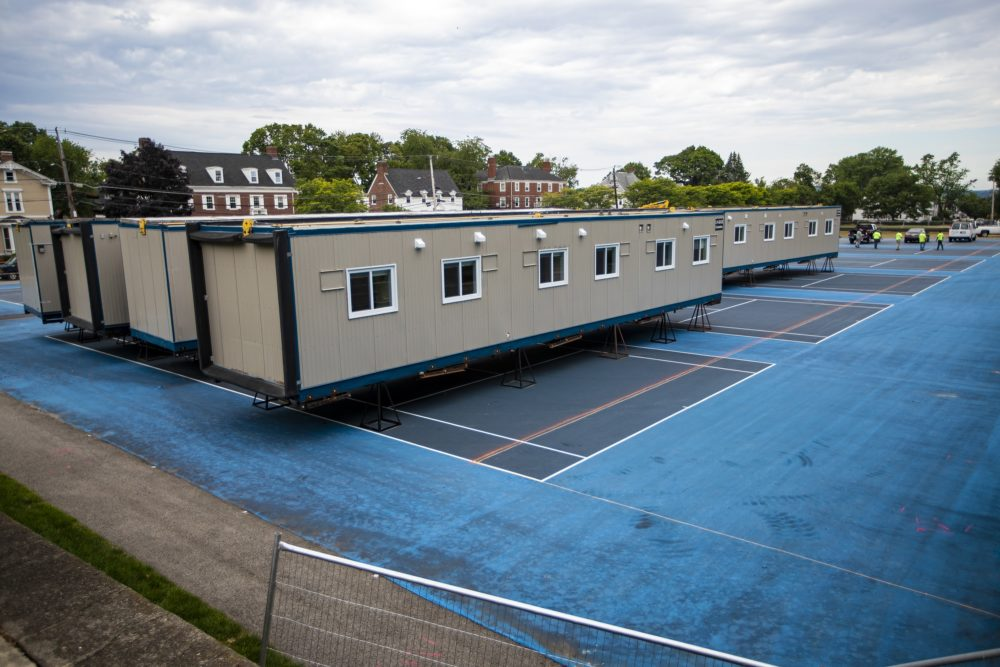 Tufts erected temporary isolation spaces on the tennis courts at Fletcher Field, across the street from the President's house. Jesse Costa/WBUR)