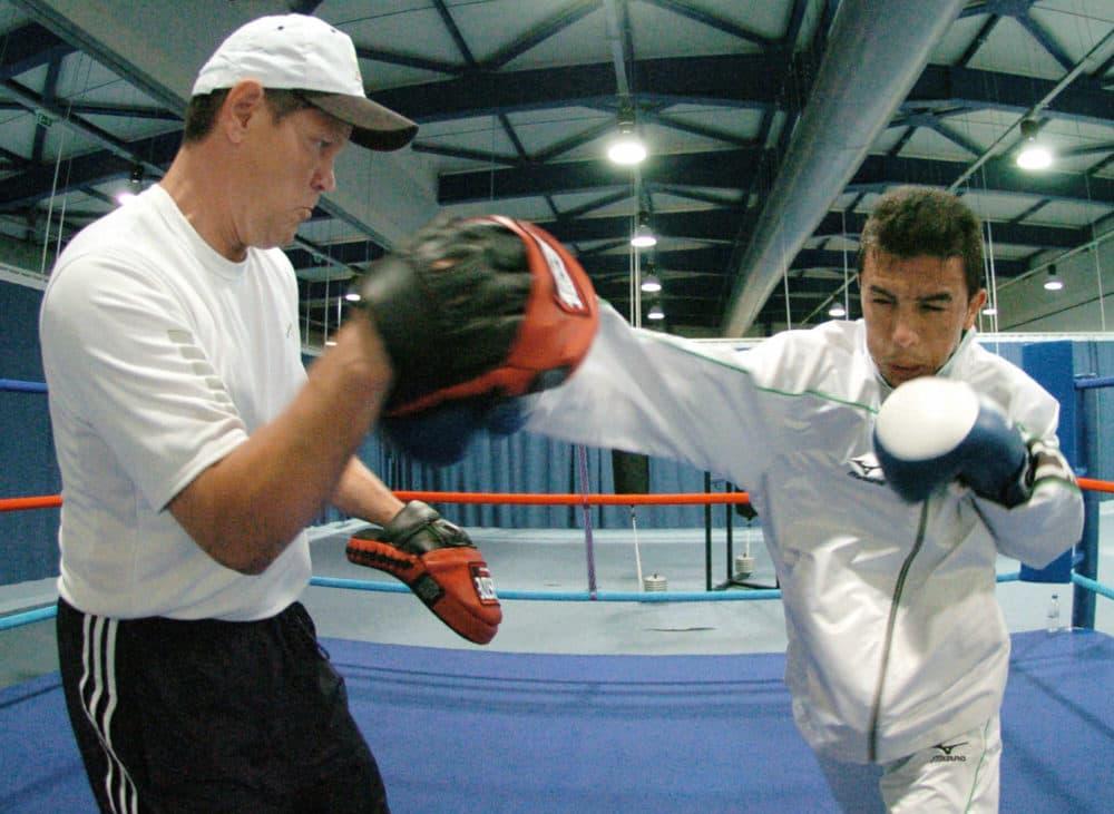 Termite Watkins (left) trains Iraqi boxer Najah Ali for the 2004 Summer Olympics. (Joe Klamar/AFP via Getty Images)