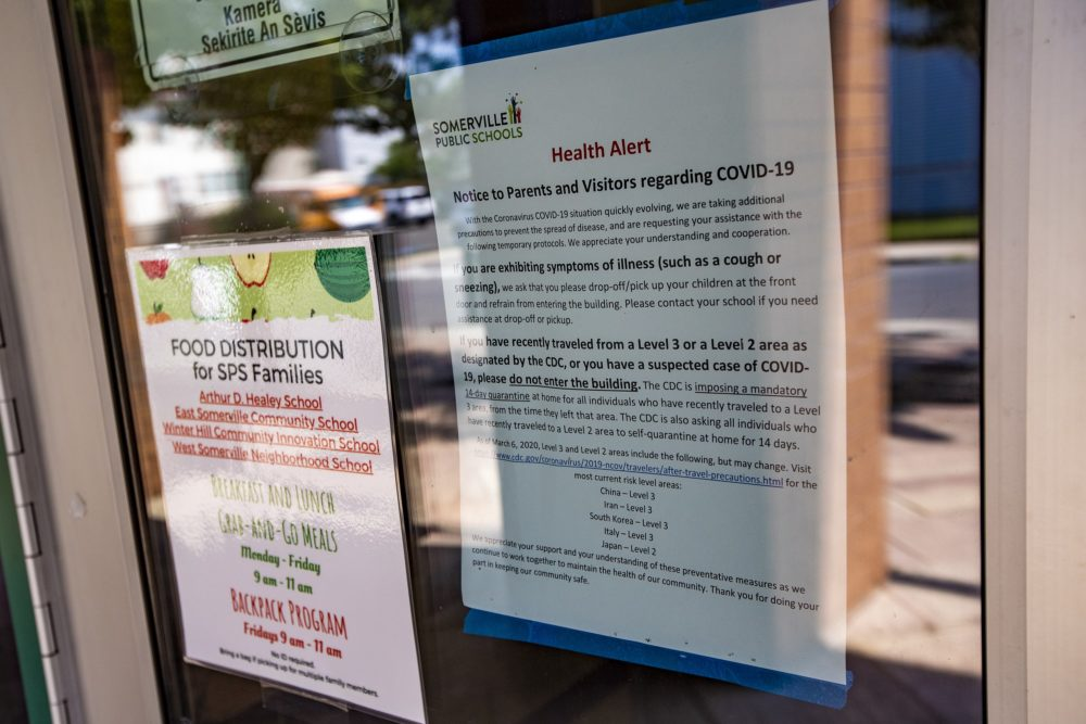 A health alert notice to parents and visitors regarding COVID-19 at the entrance of the Michael E. Capuano Early Education Center. (Jesse Costa/WBUR)