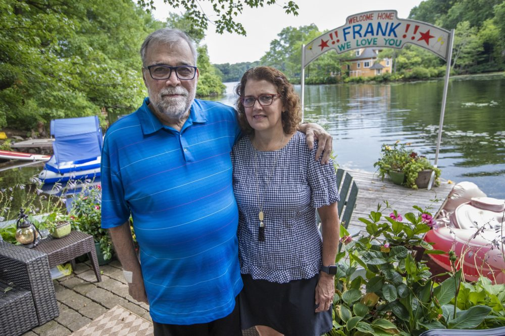 Frank and Leslie Cutitta at their home in Wayland where a banner still hangs for his return from the hospital. (Jesse Costa/WBUR)