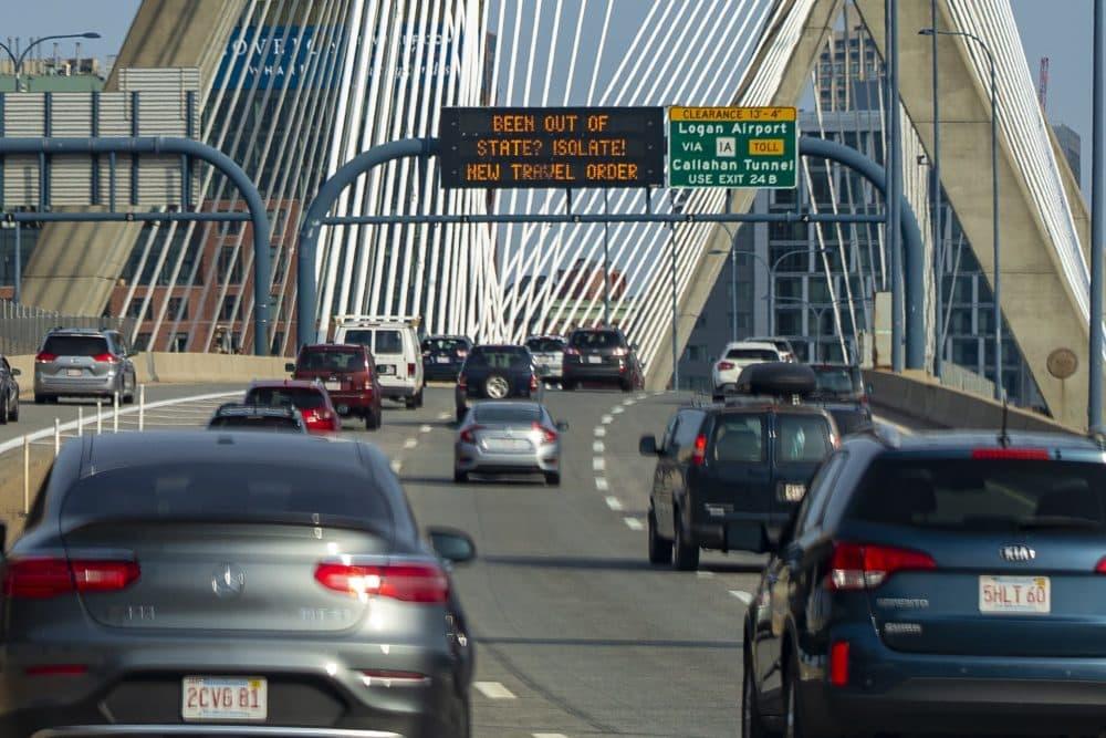 New signage on the Zakim Bridge echo the travel order goes into effect on Aug. 1. (Jesse Costa/WBUR)