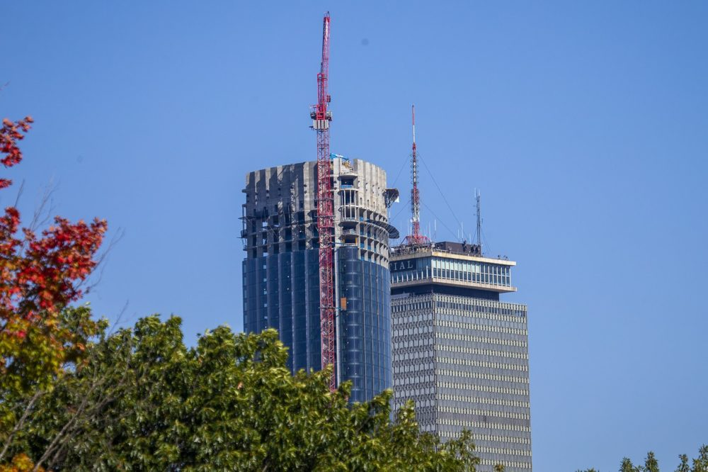 The tops of One Dalton Place and the Prudential as seen from Roxbury. (Jesse Costa/WBUR)