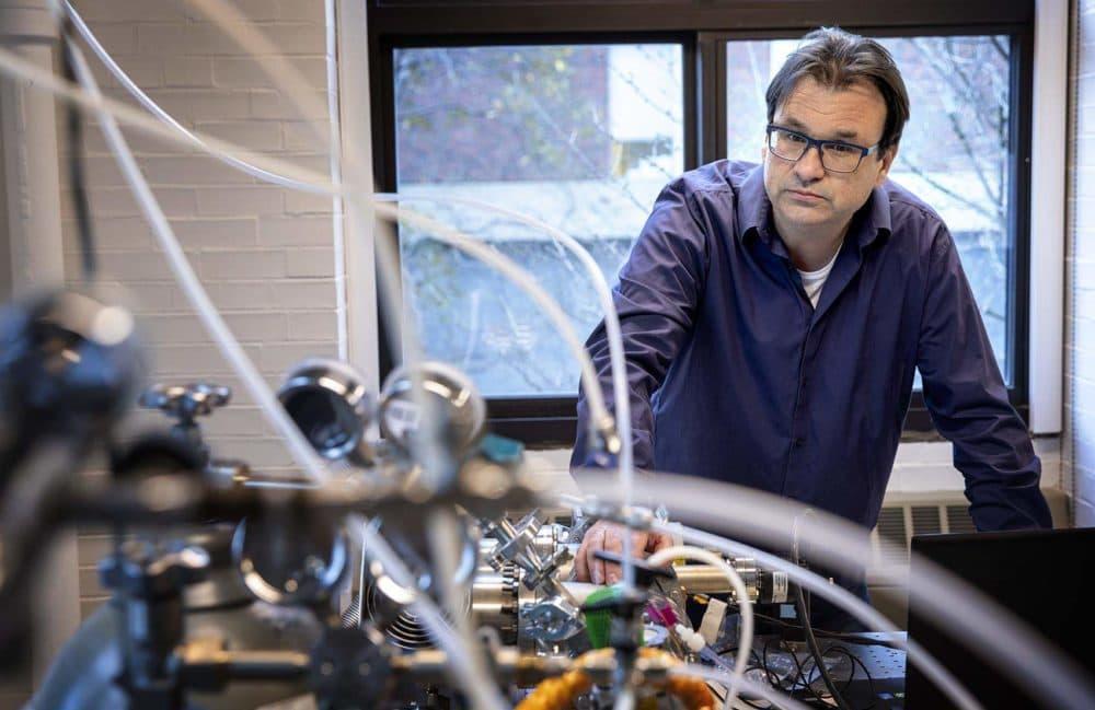 Professor Frank Keutsch looks over the mass spectrometer in his laboratory at Harvard. (Robin Lubbock/WBUR)