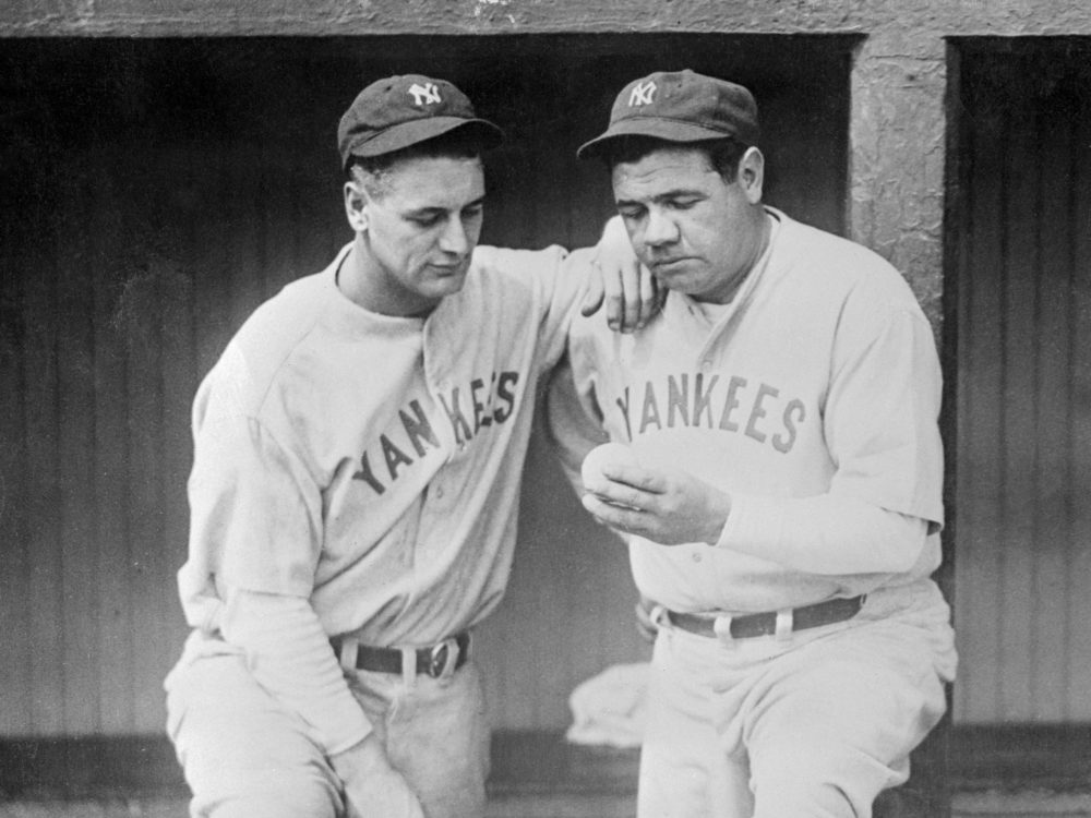 Babe Ruth (right) and Lou Gehrig (left) look at the ball which flew over the left field wall of Dunn field in Cleveland Ohio for the Babe's 500th home run of his baseball career. (Bettmann Archive/Getty Images)