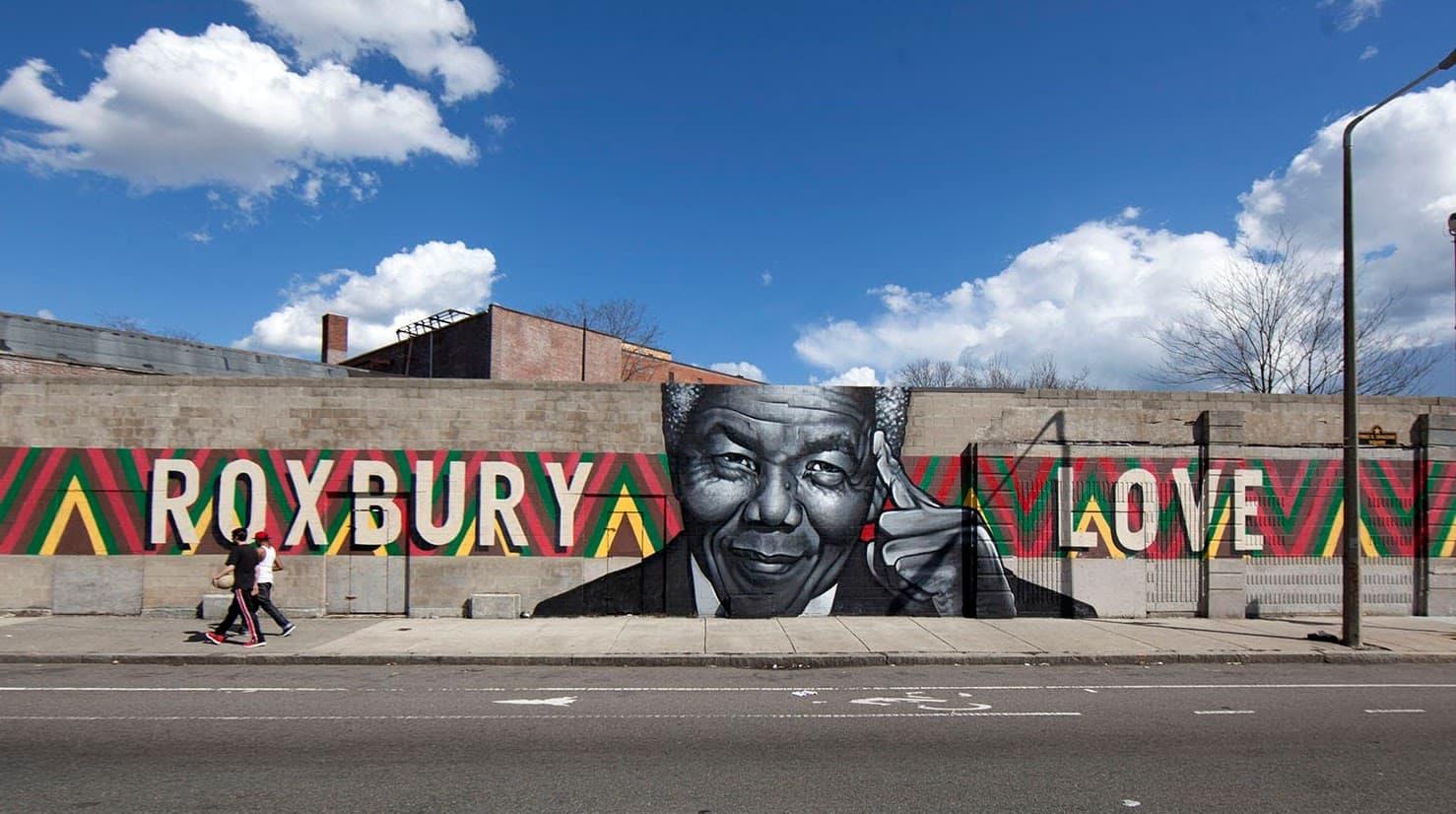 "The ""Roxbury Love"" mural on Warren Street in Roxbury before its demolition.  (Joe Difazio for WBUR)"