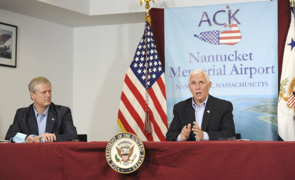 Gov. Charles Baker listens to Vice President Michael Pence speak about the federal response to the COVID-19 pandemic in Nantucket on Saturday afternoon. Pence visited Nantucket for a campaign fundraising event. (Merrily Cassidy /Cape Cod Times/AP)