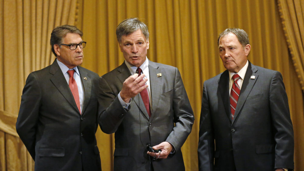 Wyoming Gov. Mark Gordon, center, speaks to reporters as U.S. Energy Secretary Rick Perry, left, and Utah Gov. Gary Herbert, right, look on during an energy summit Thursday, May 30, 2019, in Salt Lake City. (Rick Bowmer/AP)