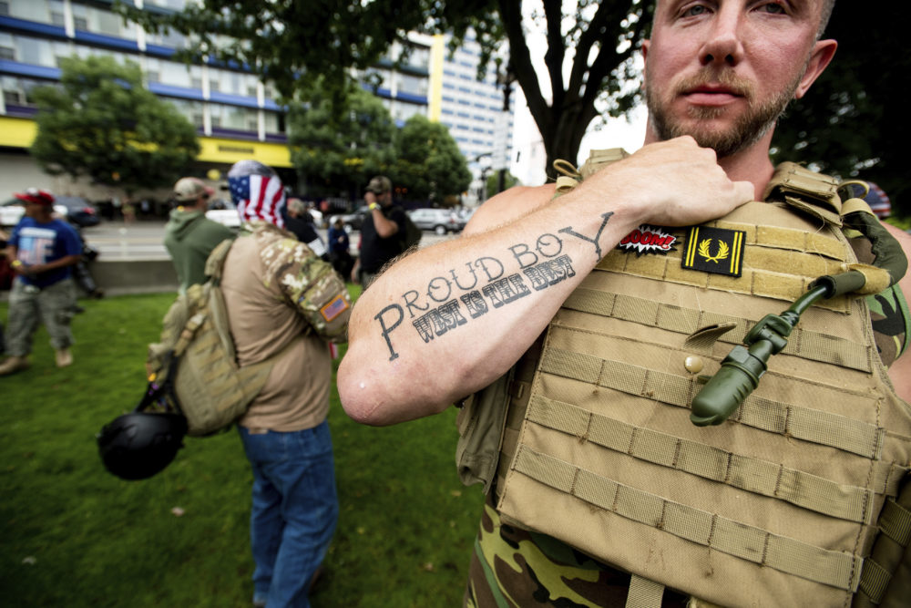 "Joseph Oakman, a member of the Proud Boys, wears body armor during an ""End Domestic Terrorism"" rally in Portland, Ore., on Saturday, Aug. 17, 2019. (Noah Berger/AP Photo)"