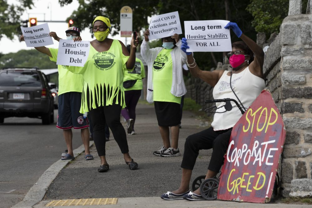 People rally for protection from evictions on June 27 in Mattapan. (Michael Dwyer/AP)