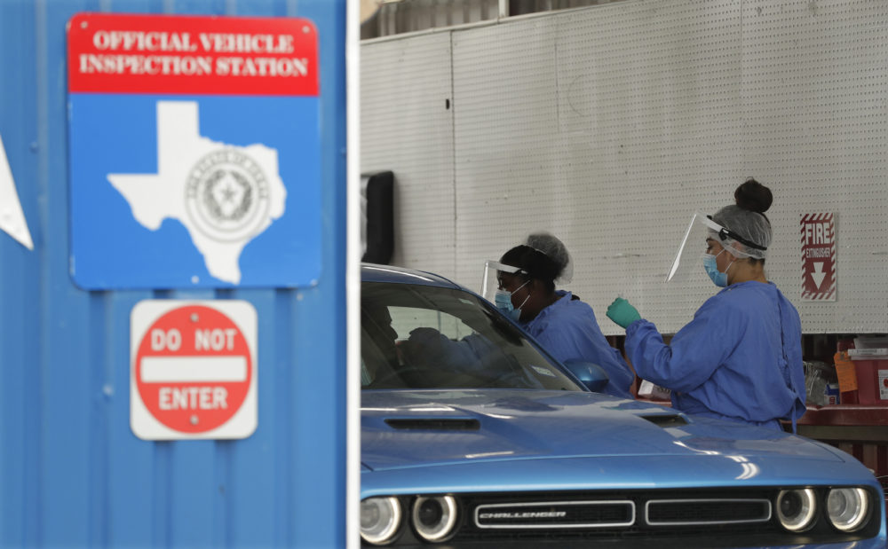 COVID-19 antibody testing and diagnostic testing are administered at a converted vehicle inspection station, Tuesday, July 7, 2020, in San Antonio. Local officials across Texas say their hospitals are becoming increasingly stretched and are in danger of becoming overrun as cases of the coronavirus surge. (Eric Gay/AP Photo)