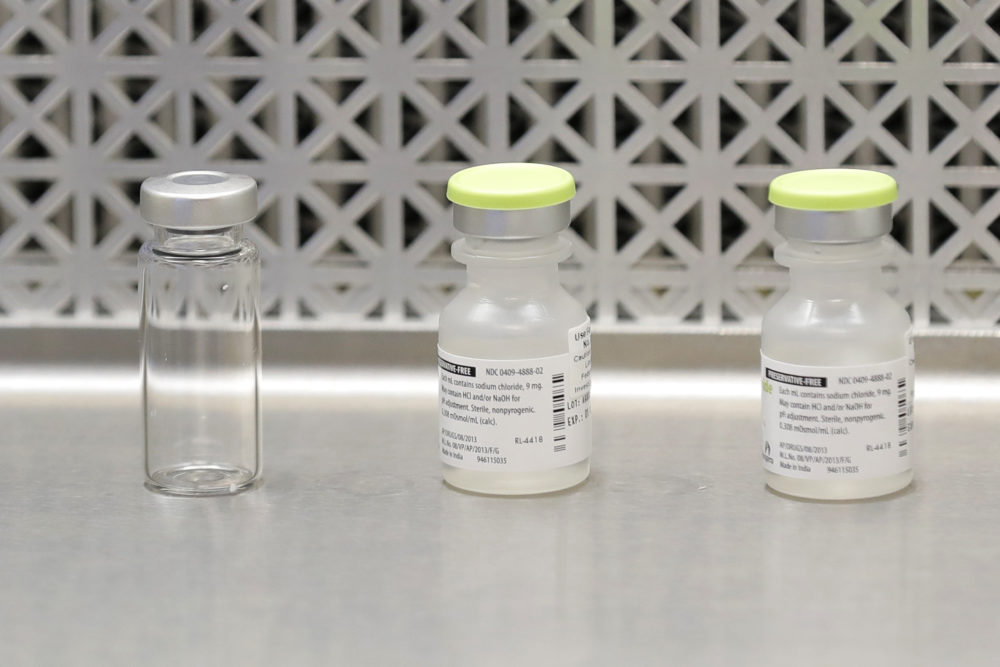 This March 16, 2020 file photo shows vials used by pharmacists to prepare syringes used on the first day of a first-stage safety study clinical trial of the potential vaccine for COVID-19, the disease caused by the new coronavirus, at the Kaiser Permanente Washington Health Research Institute in Seattle. (Ted S. Warren/AP File)