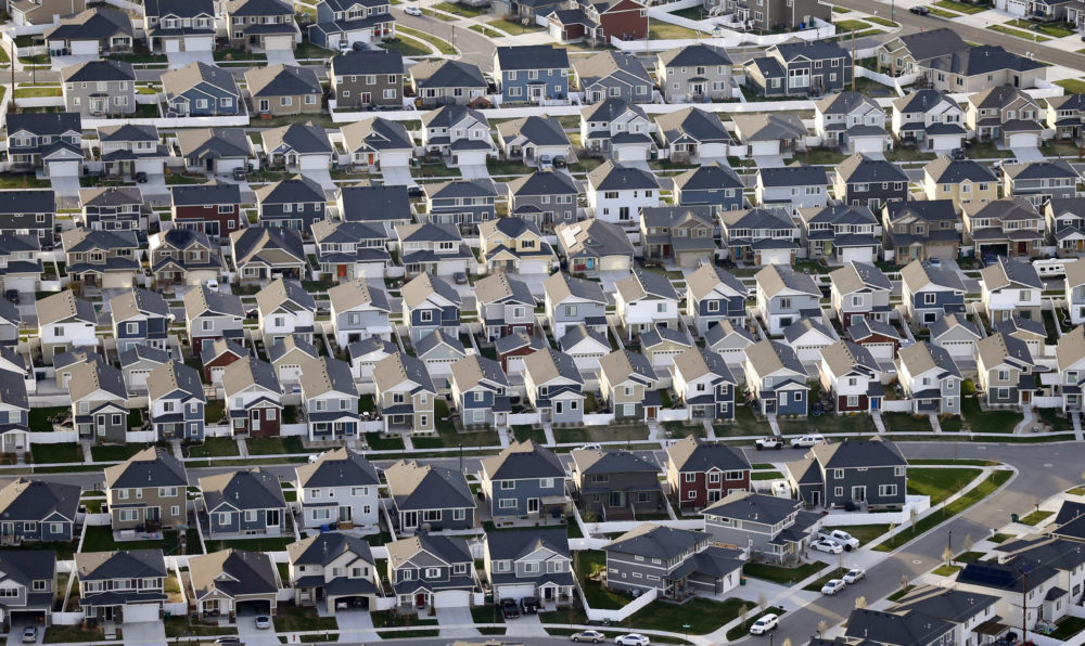 President Donald Trump's pledge to rollback an Obama-era effort to eliminate racial disparities in America's suburbs is drawing harsh criticism from fair housing advocates, who call it a blatant attempt at racial politics and an appeal to white votes before the November election. In this 2019 file photo, rows of homes are pictured in suburban Salt Lake City. (Rick Bowmer/AP)
