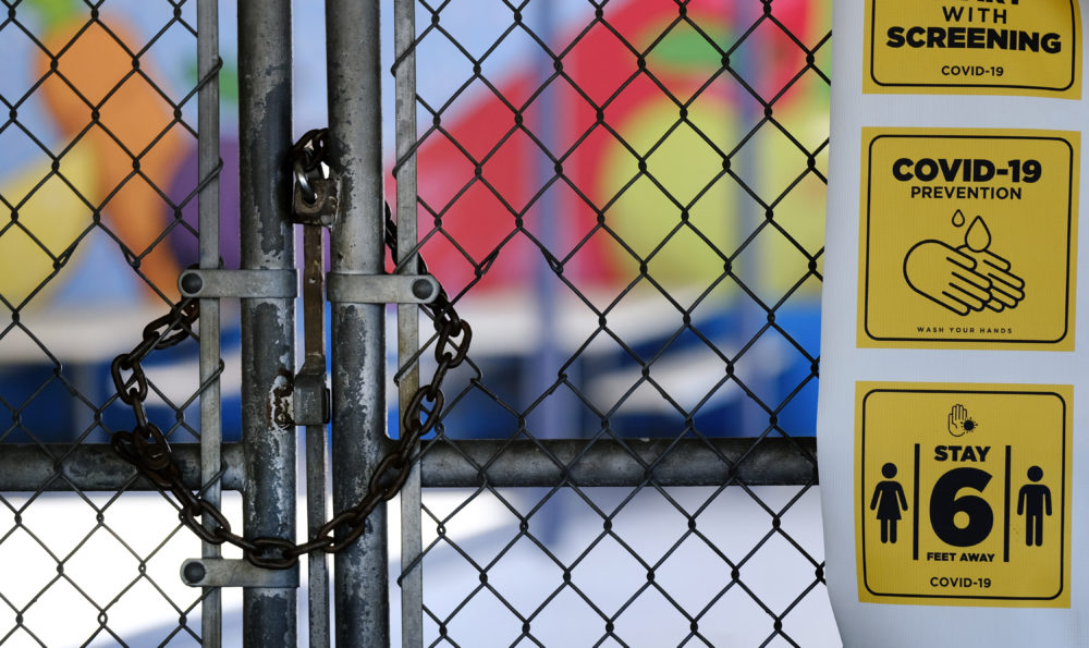 In this July 13, 2020, file photo, a chain-link fence lock is seen on a gate at a closed Ranchito Elementary School in the San Fernando Valley section of Los Angeles. (Richard Vogel/AP File)