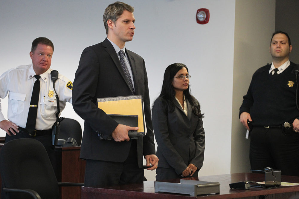 Former state lab chemist Annie Dookhan, second from right, stands in Middlesex Superior Court for arraignment on Wednesday, Jan. 9, 2013, with her attorney Nick Gordon, second left, in Woburn, Mass. Dookhan pleaded not guilty to three counts of obstruction of justice. (Suzanne Kreiter/AP Pool Photo via The Boston Globe)