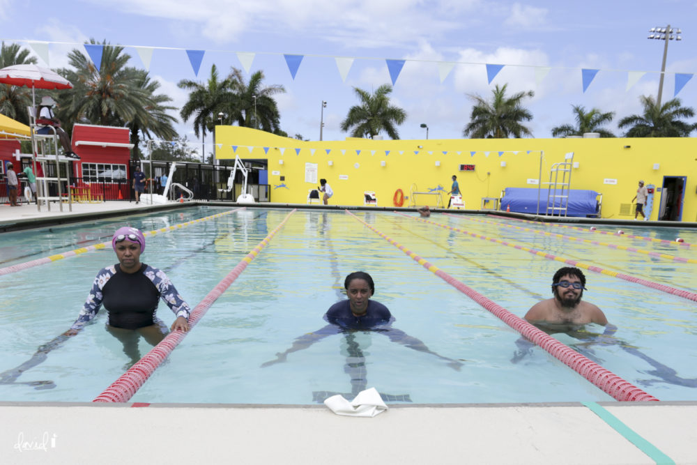 G Wright Muir (center) with her son and Niki Lopez at the Fort Lauderdale Swim-In for Restorative Justice. (David I Muir)
