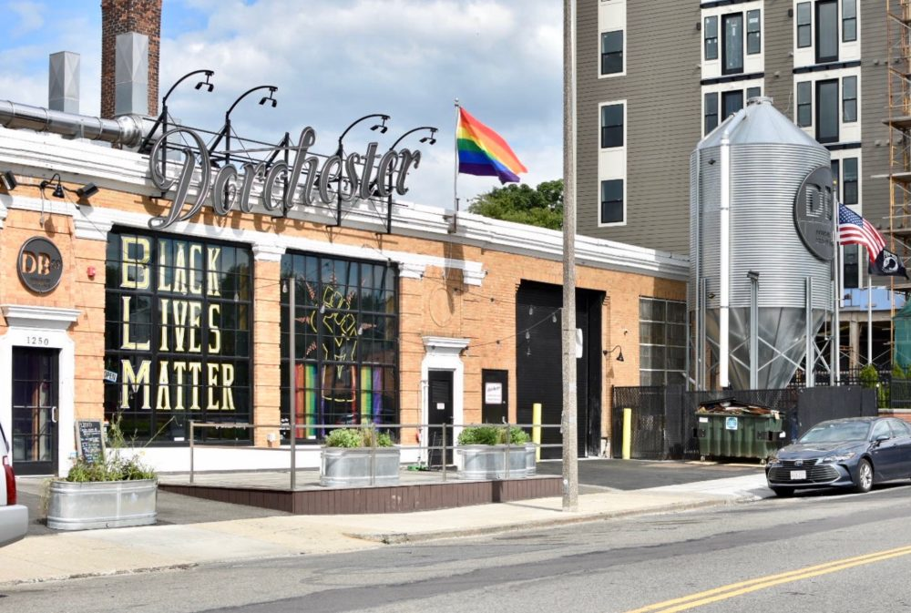 The front windows of Dorchester Brewing Company display a Black Lives Matter sign and fist. (Courtesy Dorchester Brewing Company)