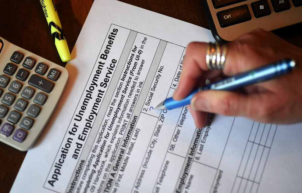 In this photo illustration, a person files an application for unemployment benefits on April 16, 2020, in Arlington, Virginia. (Olivier Douliery/AFP via Getty Images)