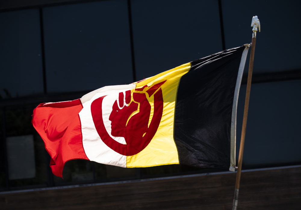 The flag of the American Indian Movement flies outside the American Indian Center during a demonstration on June 7, 2020 in Minneapolis, Minnesota. The protest, led by Native Lives Matter to honor George Floyd, drove from North Minneapolis to the American Indian Center then continued to the memorial site where Floyd was killed. (Stephen Maturen/Getty Images)