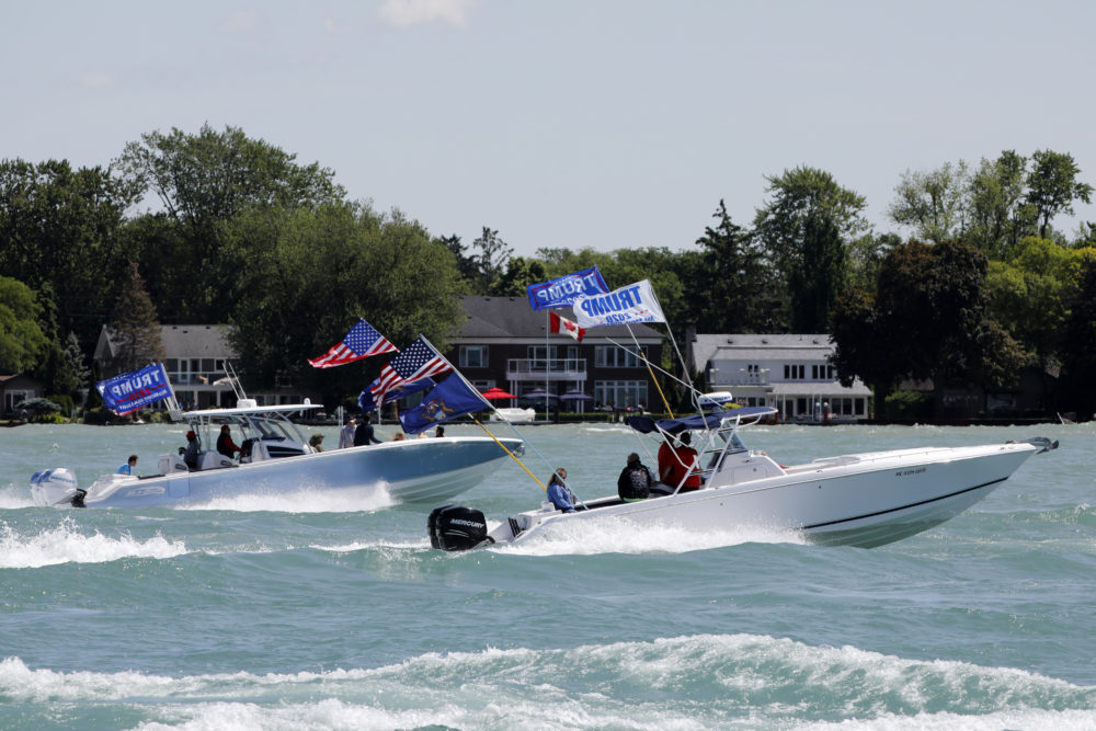"""Boaters participate in the """"Make america Great Again"""" parade as they celebrate US President Donald Trump's 74th birthday on the Detroit River in Detroit, Michigan on June 13, 2020. - The parade is hosted by the Michigan Conservative Coalition and Michigan Trump Republicans 2020. (Jeff Kowalsky/AFP)"""