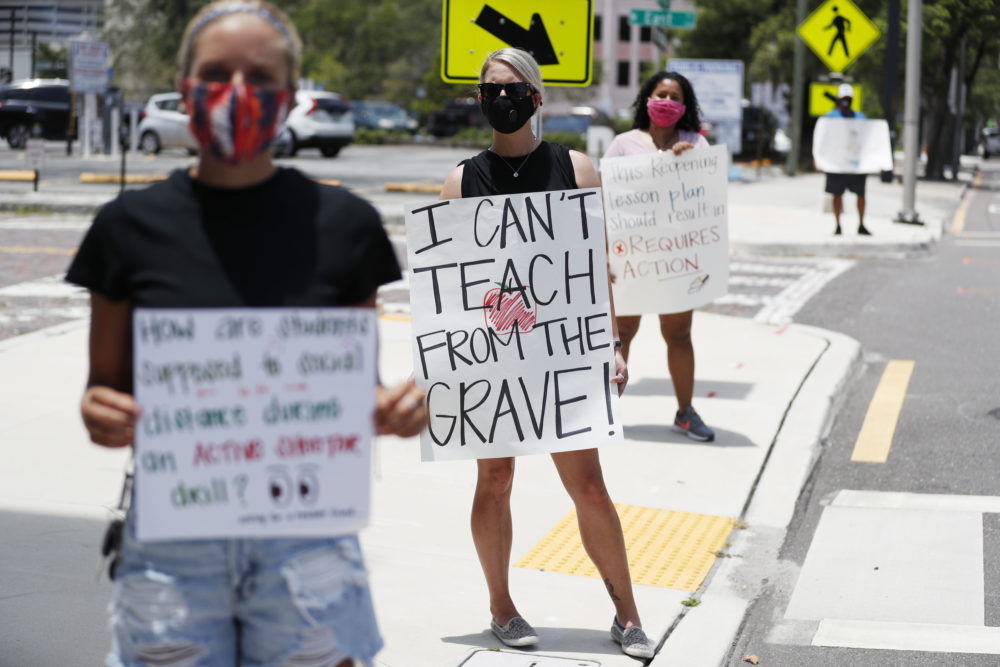 Middle school teacher Brittany Myers, (C) stands in protest in front of the Hillsborough County Schools District Office on July 16, 2020 in Tampa, Florida. (Octavio Jones/Getty Images)