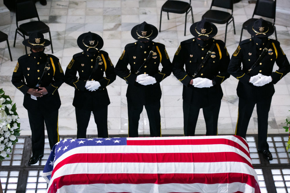 Members of the Fulton County Sheriff's Office Honor Guard stand at attention in front of former US Rep. John Lewis (D-GA) as he lies in state at the Georgia State Capitol on July 29, 2020 in Atlanta, Georgia. (Jessica McGowan/Getty Images)