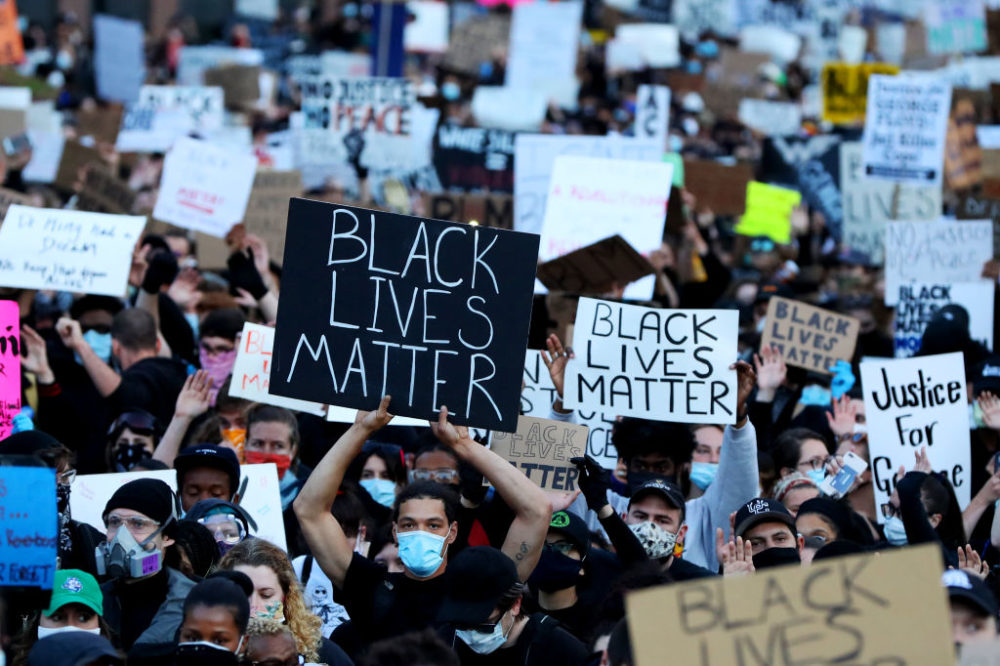 Demonstrators in Boston, Massachusetts, protest in response to the death of George Floyd. (Maddie Meyer/Getty Images)
