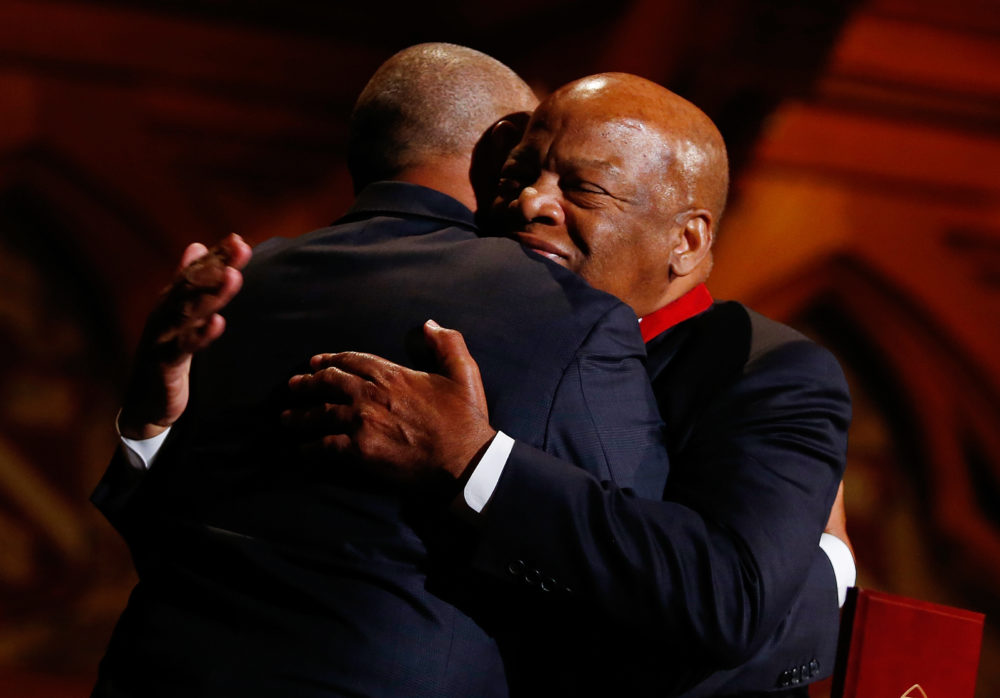 Congressman John Lewis, right, hugs former Governor Deval Patrick during the Hutchins Center Honors W.E.B. Du Bois Medal Ceremony in Cambridge, Mass. on September 30, 2014. (Photo by Jessica Rinaldi/The Boston Globe via Getty Images)