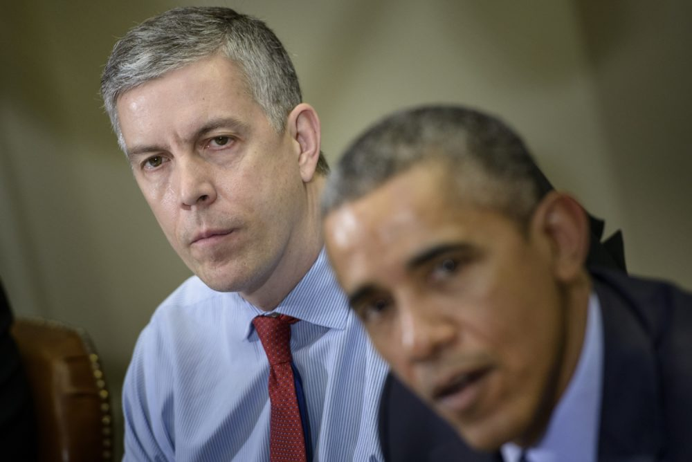 Former U.S. Secretary of Education Arne Duncan listens while former President Barack Obama makes a statement to the press in 2015. (Brendan Smialowski/AFP/Getty Images)