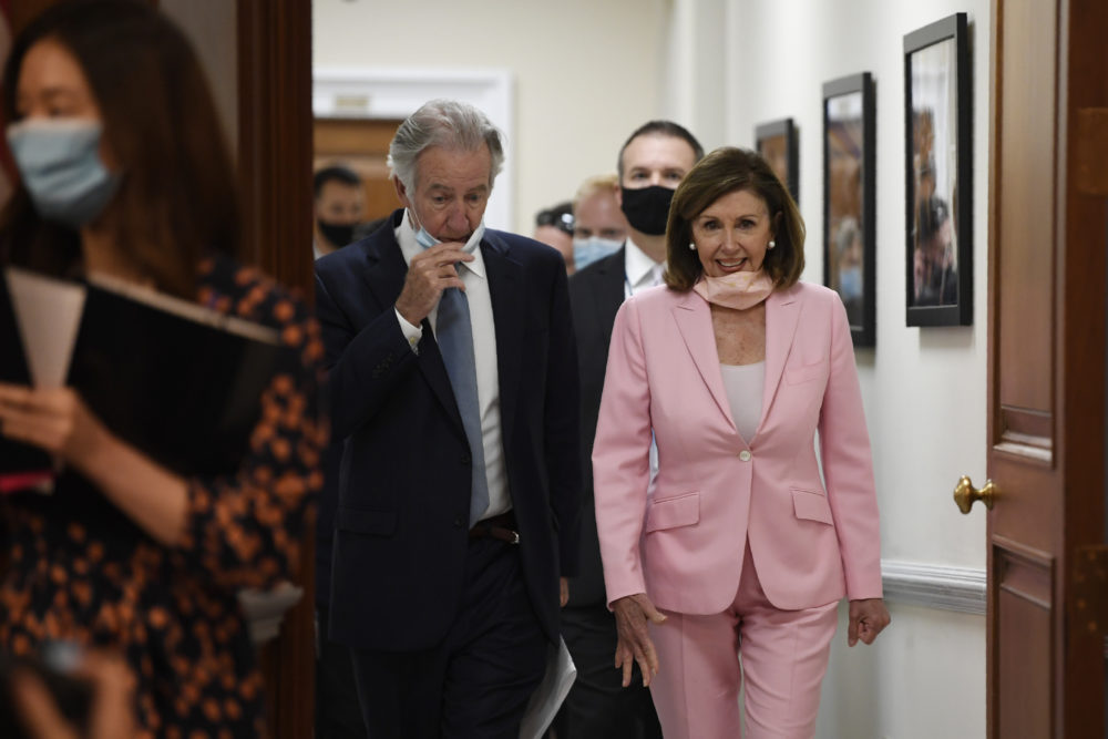 House Speaker Nancy Pelosi and Rep. Richard Neal arrive for an event on the Moving Forward Act, Thursday, June 18, Washington. (AP Photo/Susan Walsh)