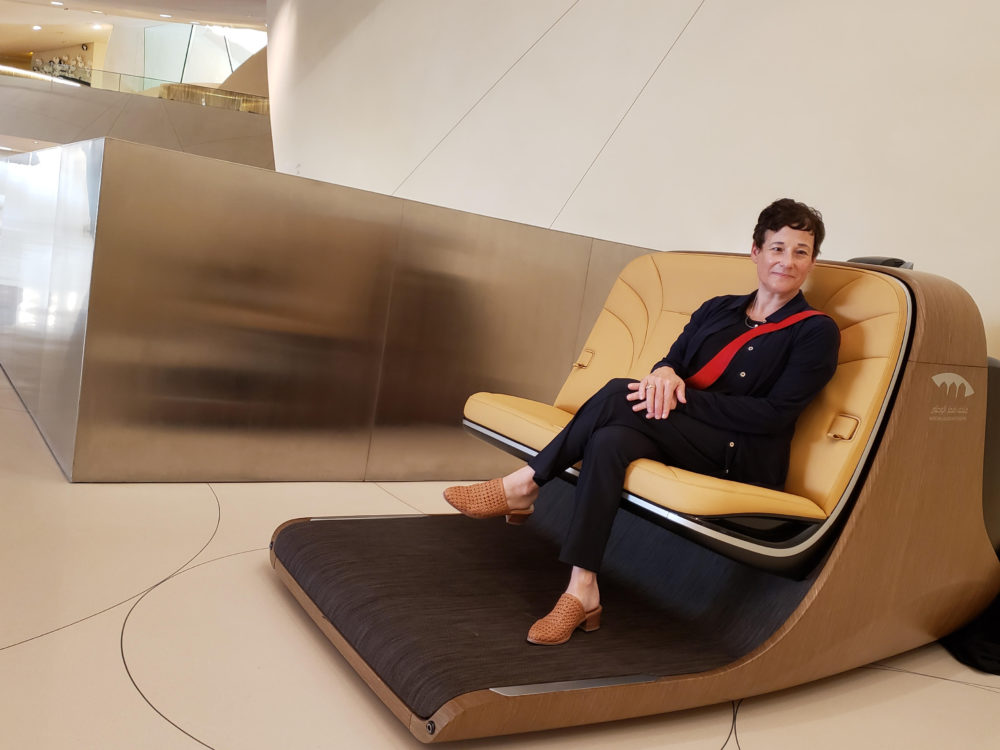Sandy Goldberg sits in a special chair at the National Museum of Qatar, one of her many museum clients around the world. (Courtesy of Sandy Goldberg)