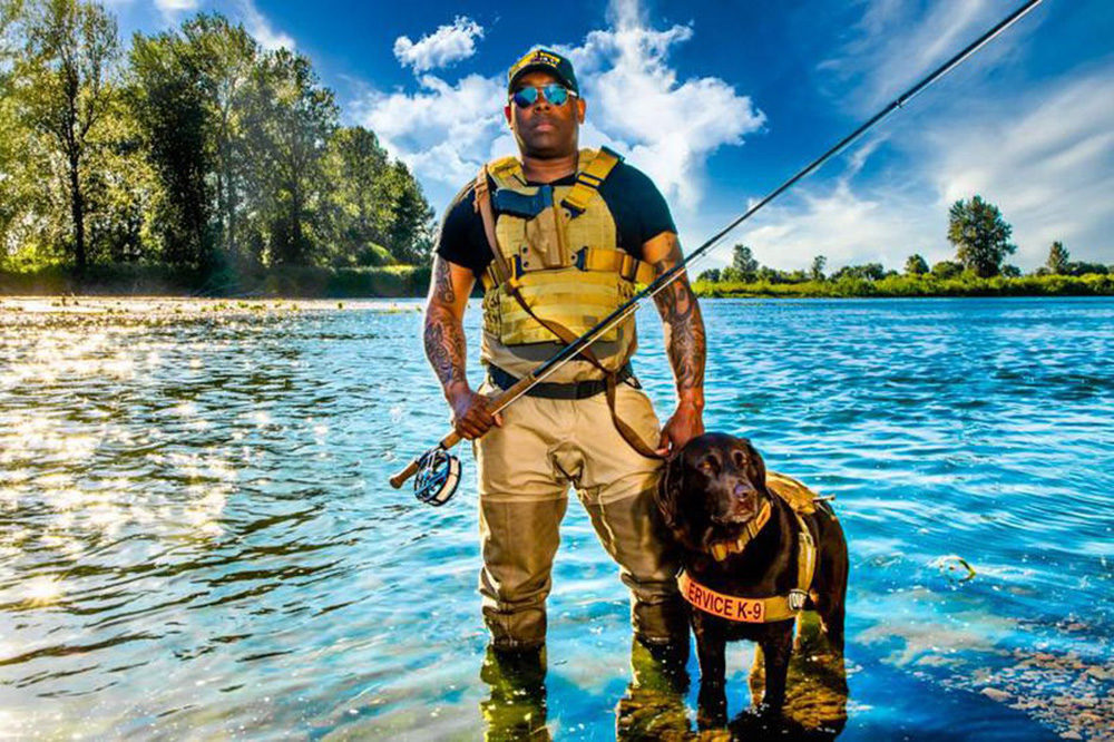 Chad Brown with his dog Axe on the Willamette River, Oregon. (Courtesy of Chad Brown)